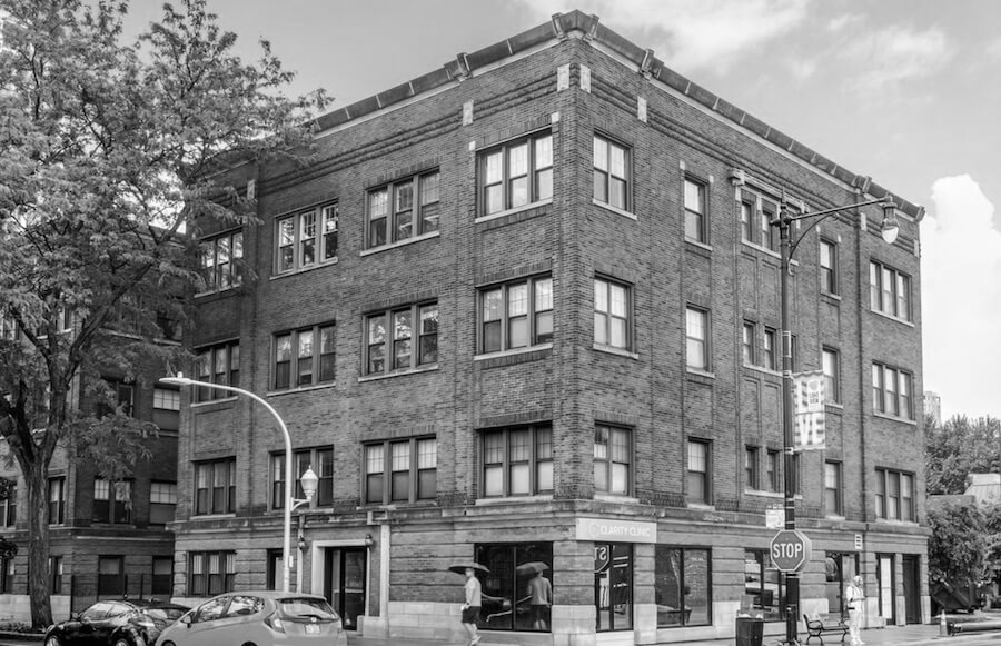 Waveland black and white 4 story building